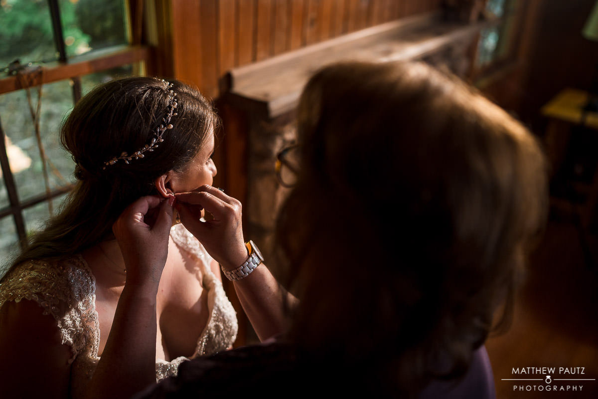 bride getting ready in cabin before wedding