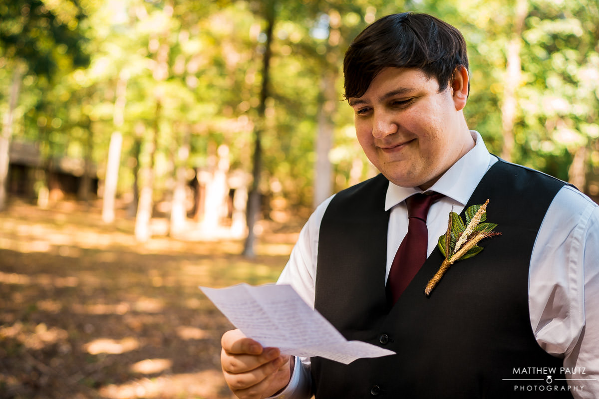 groom reading a note before wedding