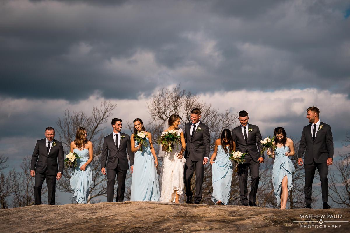 Bridesmaids and groomsmen walking at Cliffs at Glassy Chapel