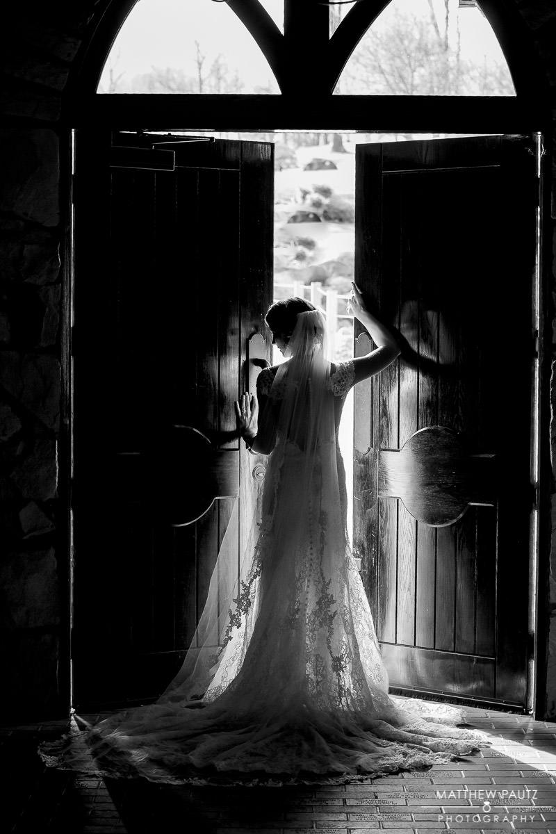 Bride opening door to Cliffs at Glassy Chapel