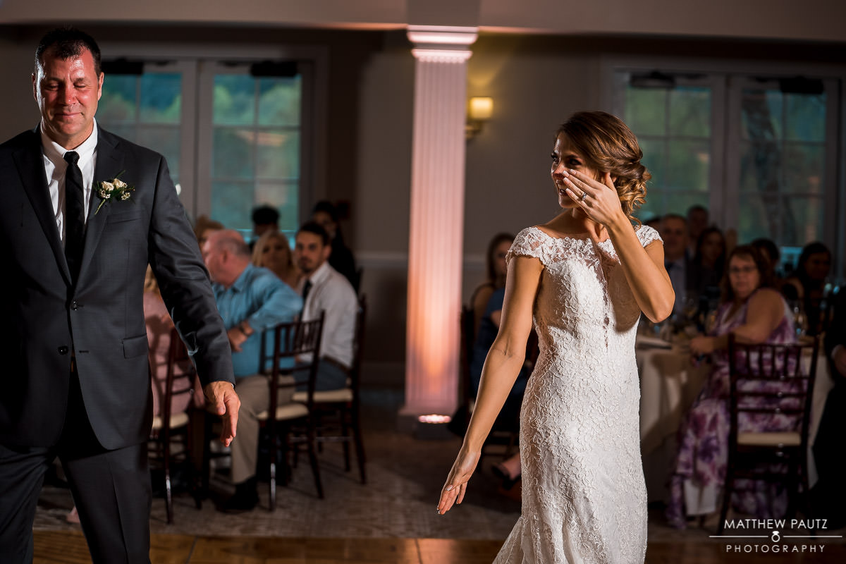 Bride crying after father daughter dance at wedding reception