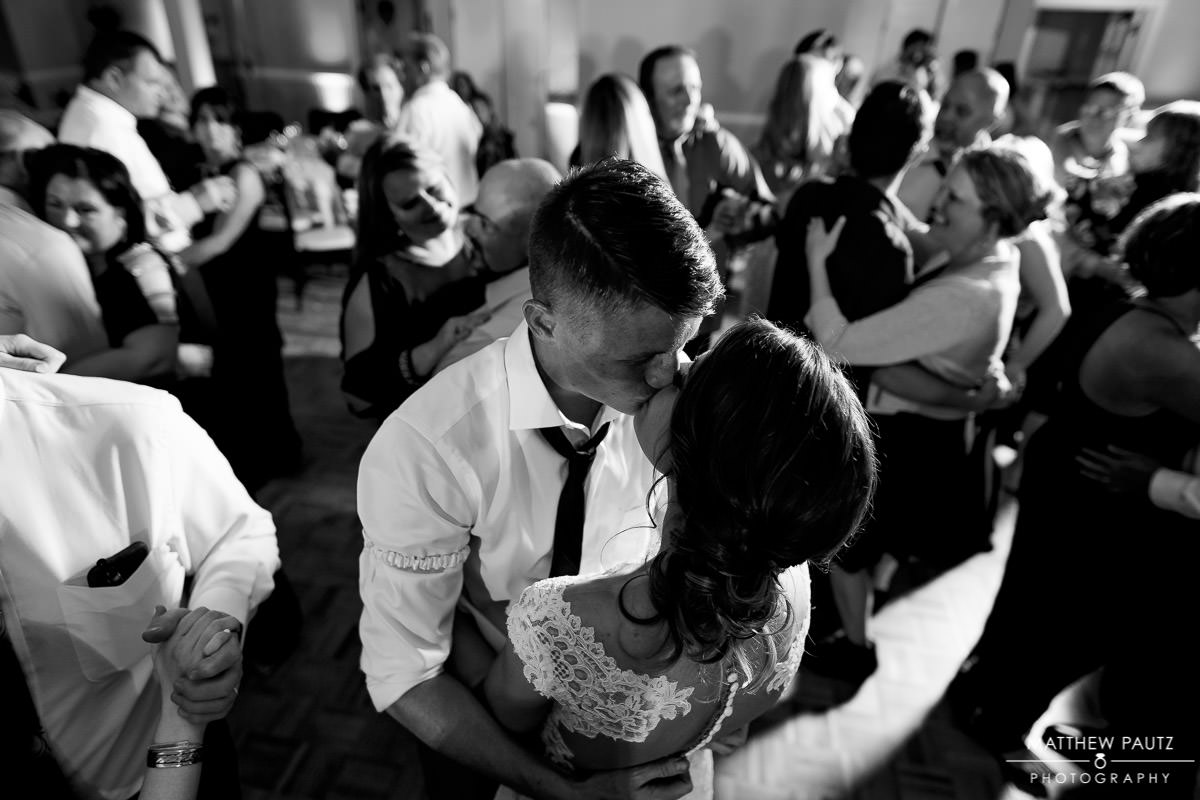 Bride and groom kissing on dance floor at Cliffs at Glassy wedding reception