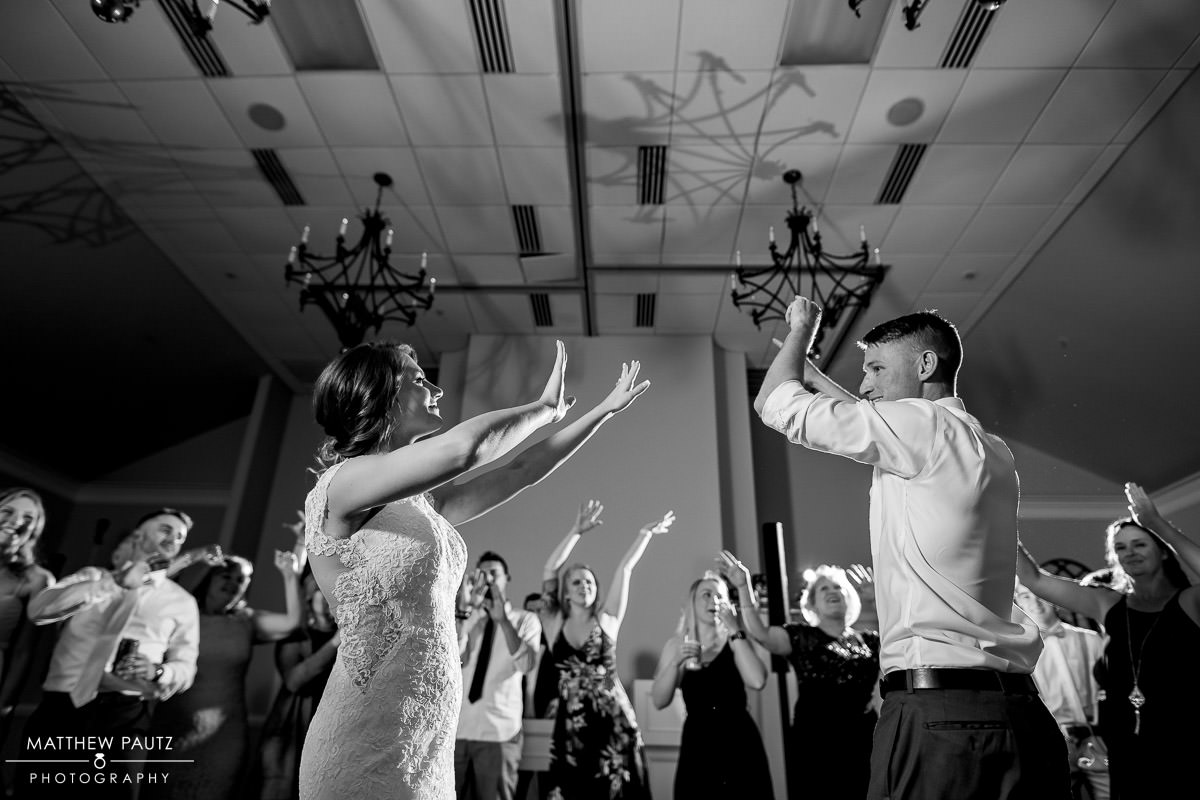 Bride and groom dancing at wedding reception