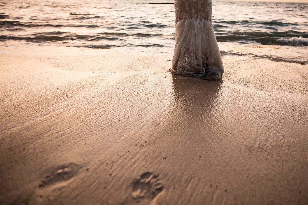 destination wedding photo of a bride walking on the beach in Mexico