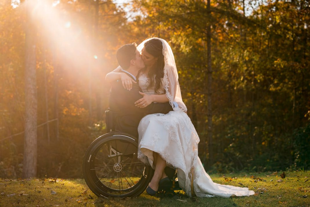 bride and groom in wheelchair at wedding reception