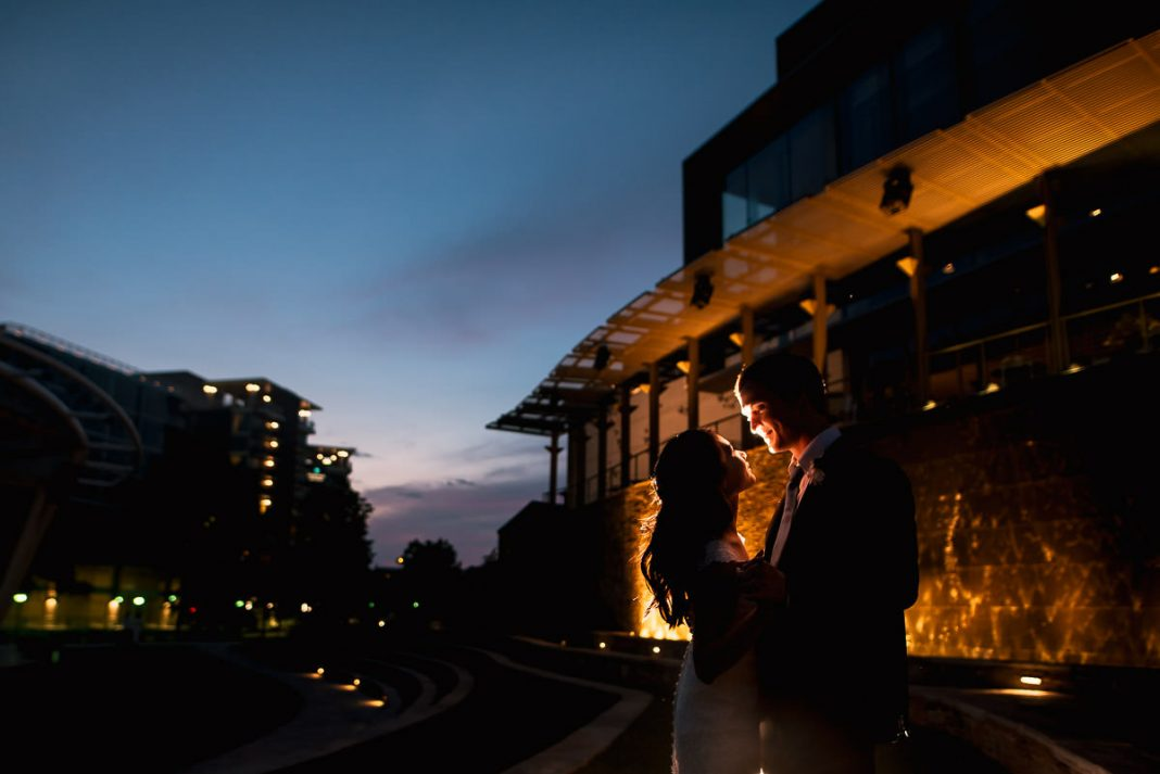 bride and groom dancing at sunset in greenville sc
