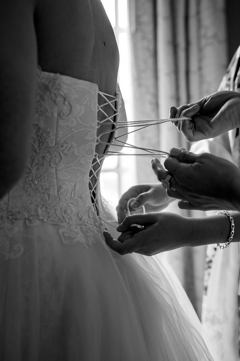 Bride getting dressed before wedding day
