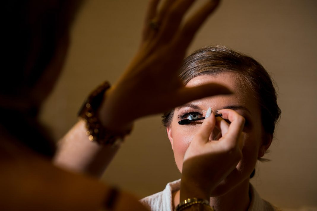 Interesting photos of bride having makeup applied
