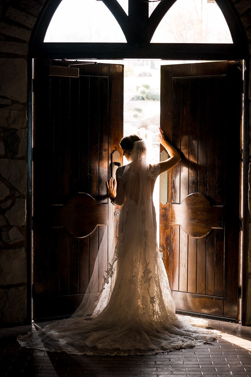 Bride opening doors at church wedding