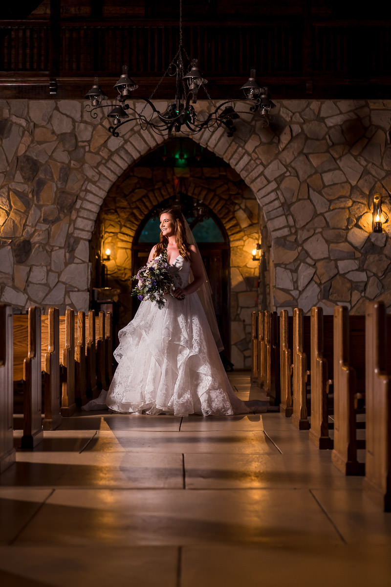 Cliffs at glassy chapel bridal photo