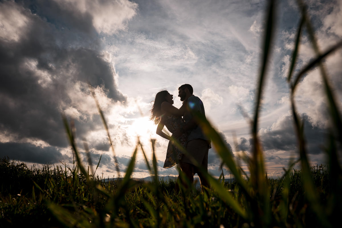 engaged couple dancing in blue ridge mountains