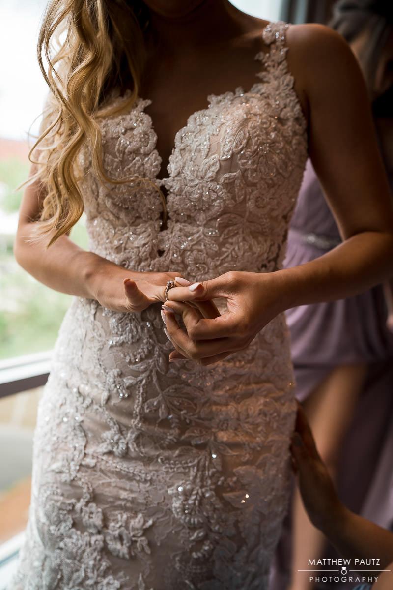 bride admiring engagement ring on her finger