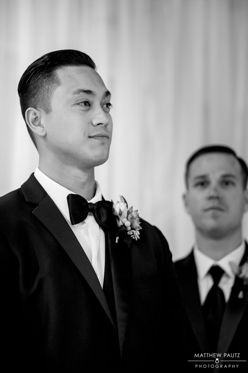 groom sees bride walking down the aisle at huguenot loft