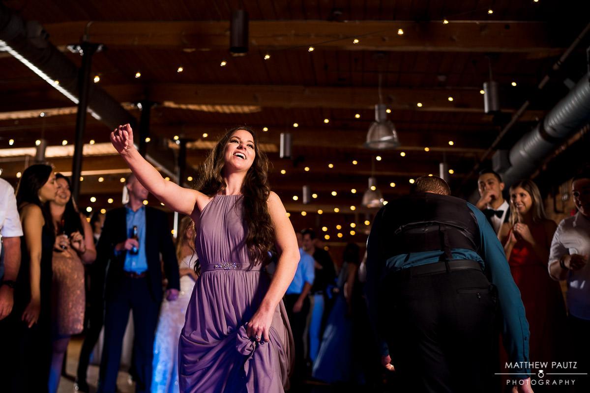 bridesmaid dancing and having fun after wedding