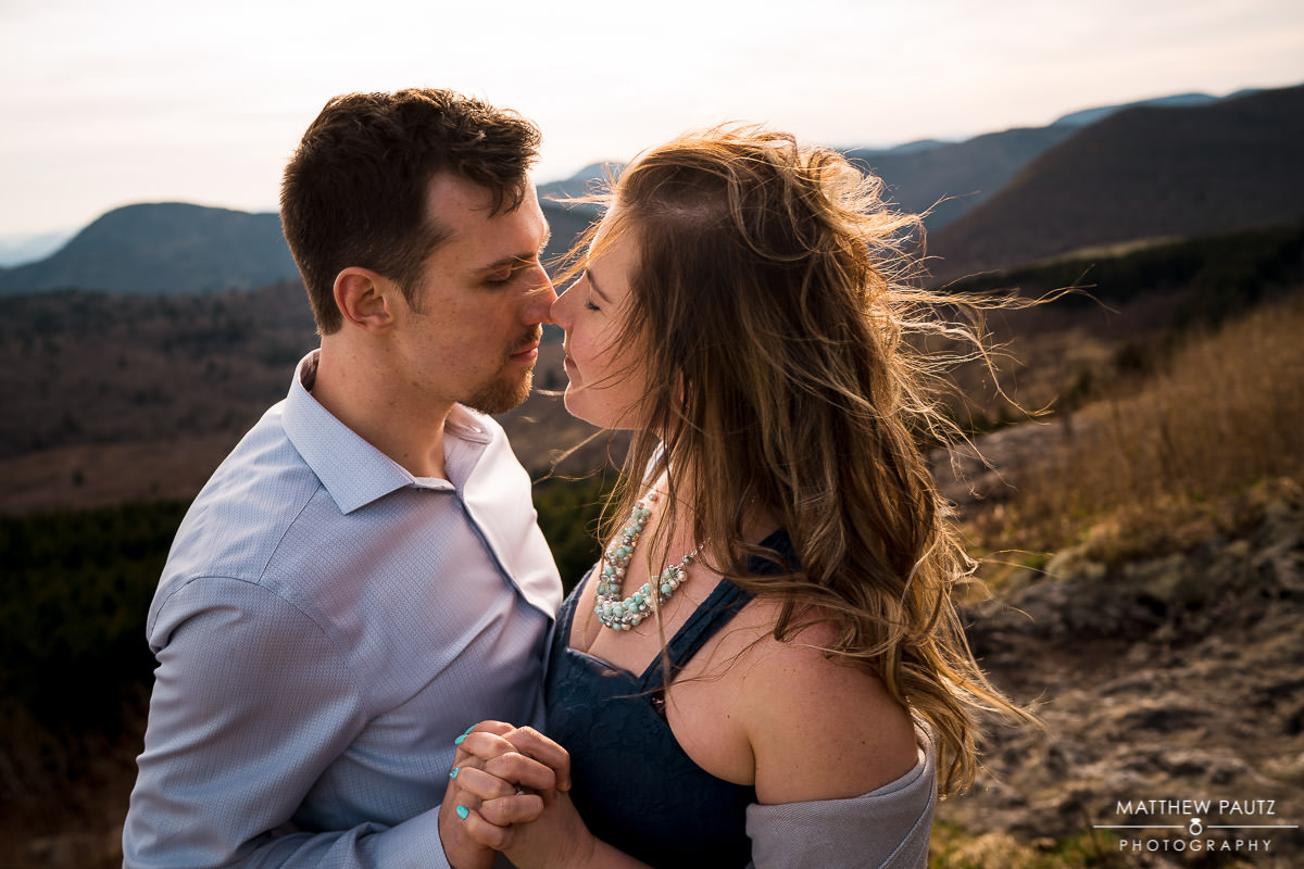 windy mountain engagement photos