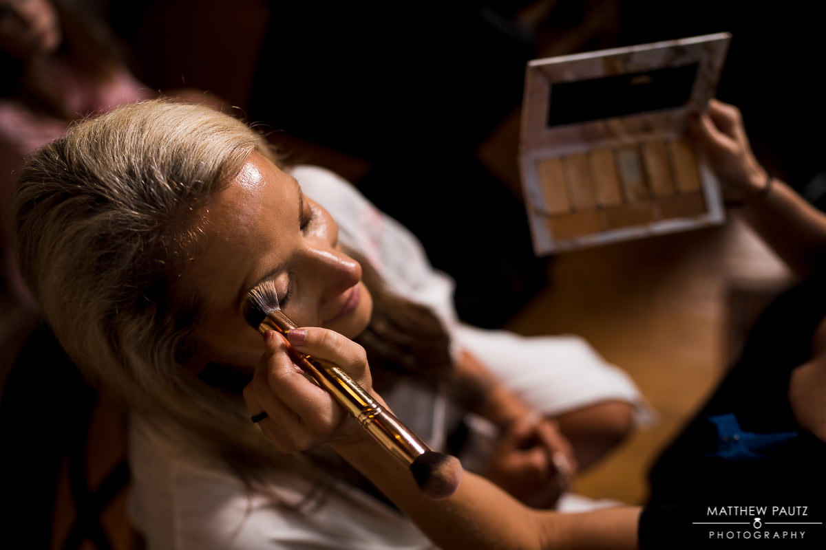 bride gets her makeup applied before wedding ceremony at viewpoint at buckhorn creek