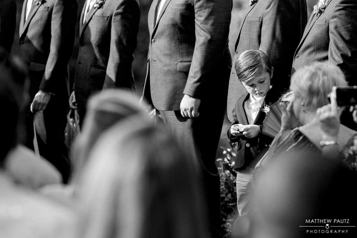 ring bearer getting distracted during wedding ceremony