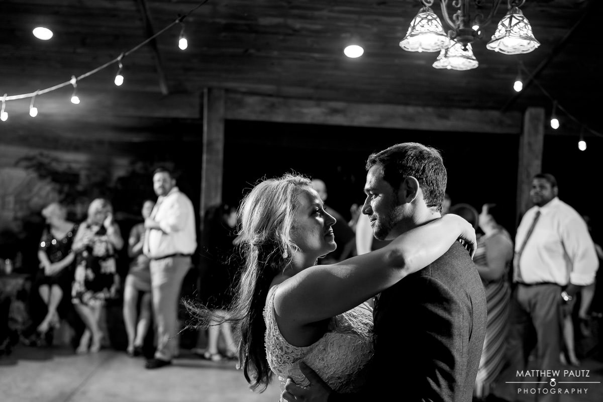 bride and groom dancing together during wedding reception at viewpoint at buckhorn creek