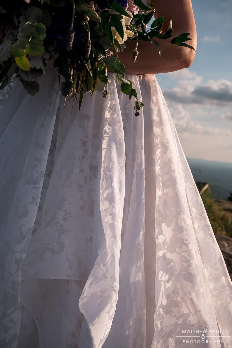 closeup of bride's wedding dress details