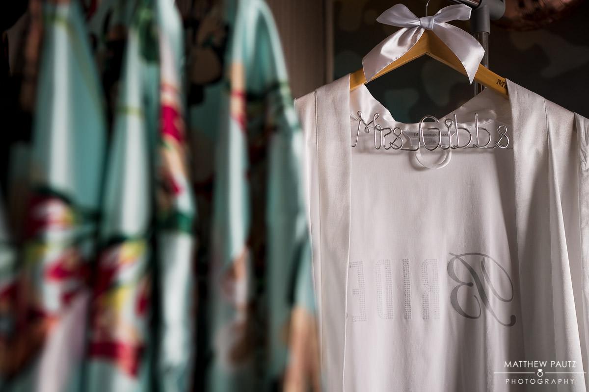 closeup photo of bridesmaids robes