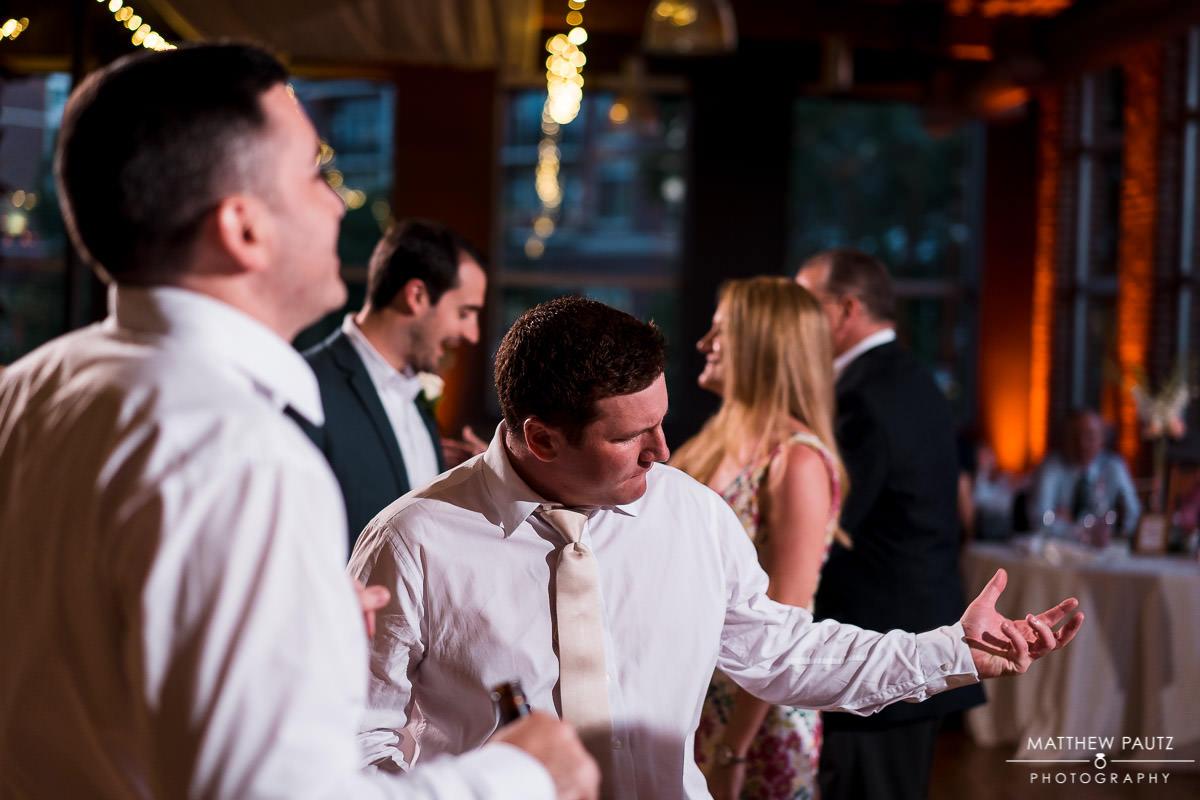 groomsman dancing at wedding reception