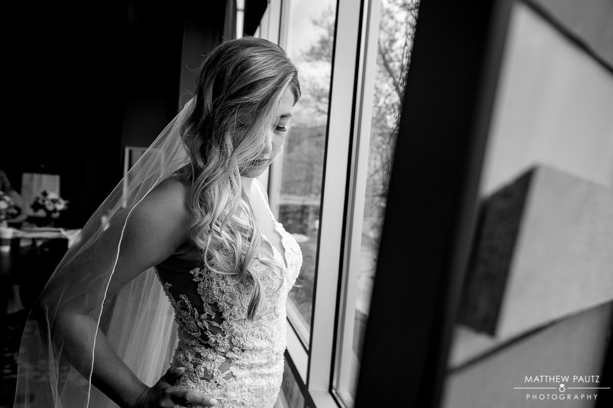 Bride getting ready before wedding ceremony at huguenot loft