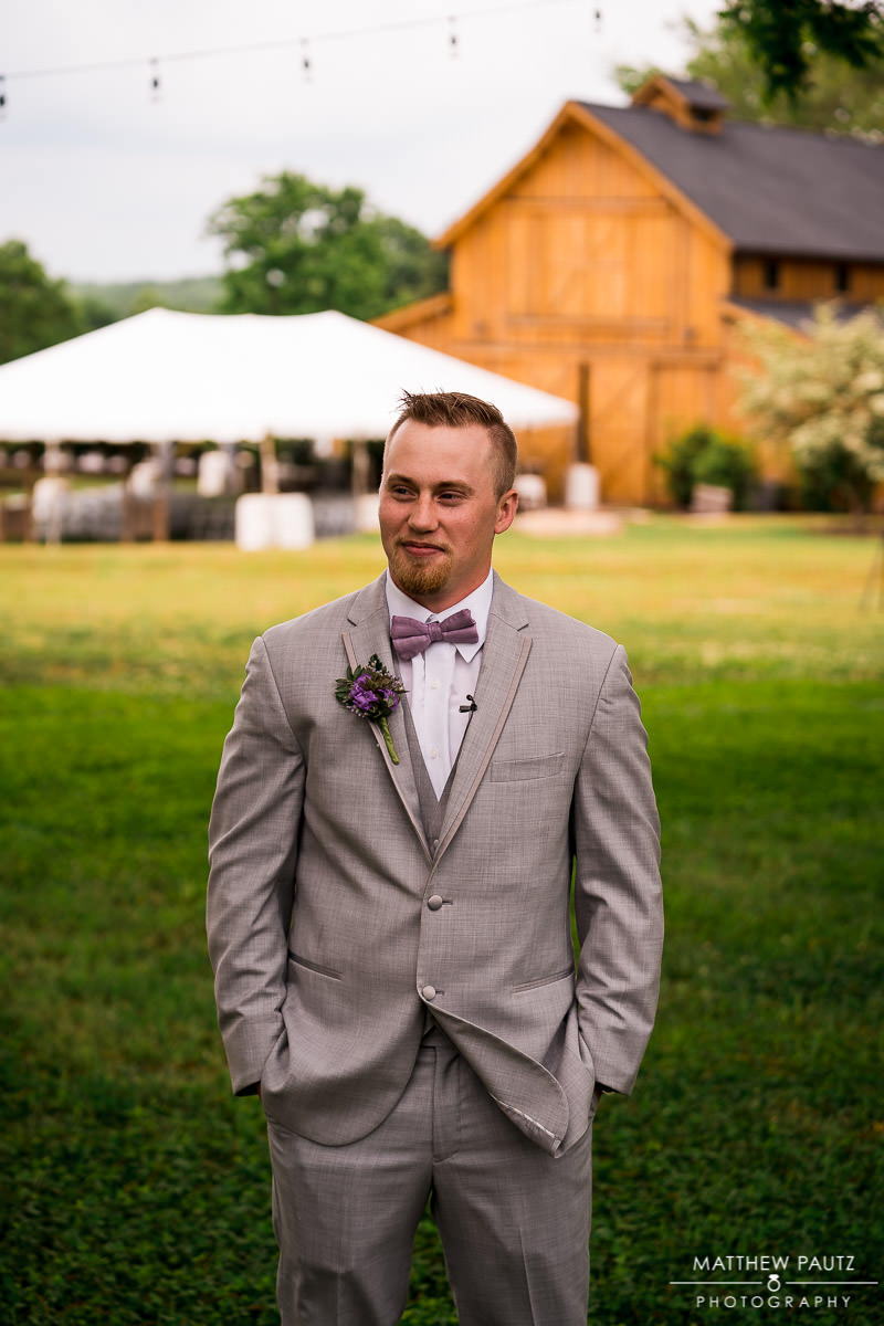 groom waits to see bride for first look before wedding