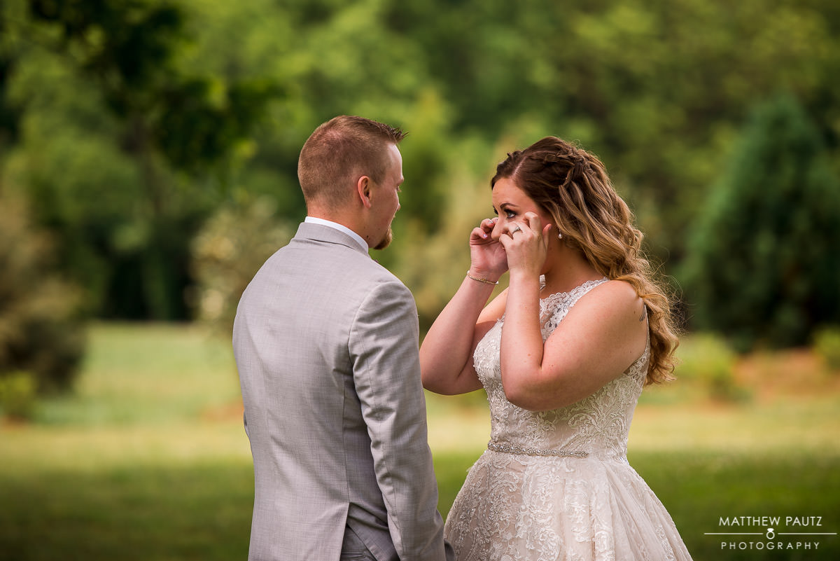 bride cries when seeing groom for first time