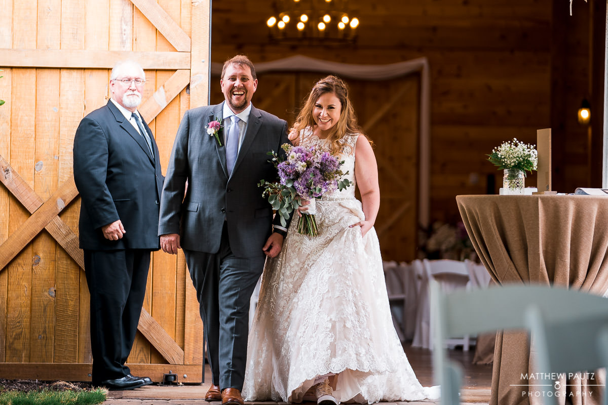 bride walking with father at windy hill farm wedding ceremony