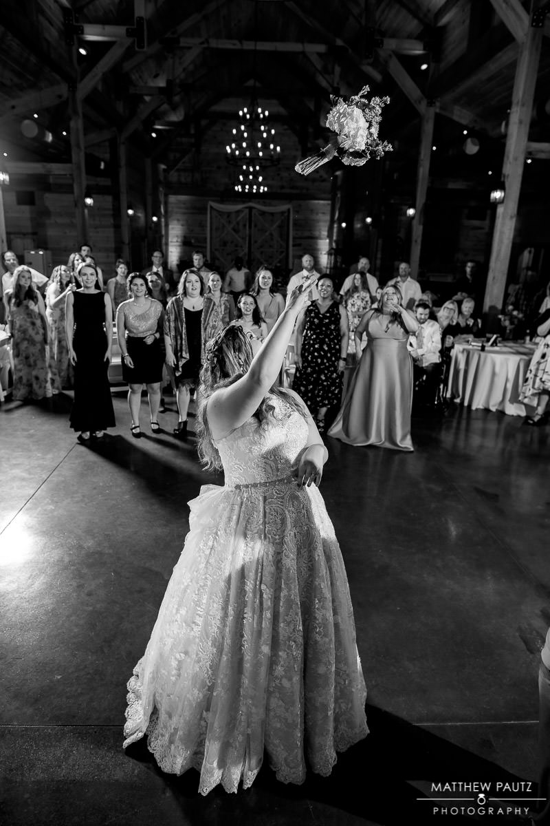 bride tossing bouquet at windy hill wedding reception