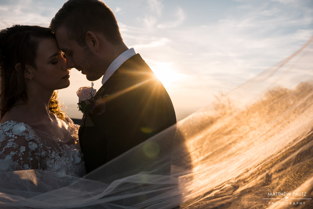 bride and groom together at sunset in greenville sc